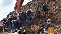 İş makinesinin üzerine toprak kaydı, operatör güçlükle kurtarıldı
