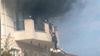 Villa yangınından yeni görüntüler: Alevlerden kaçmak için dakikalarca balkondan aşağı sarktı