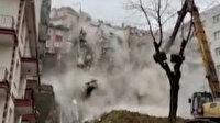 Çökme tehlikesi olan binanın yıkılma anları kamerada