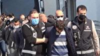 Adana'da silah kaçakçılığından gözaltına alınan 20 zanlı adliyeye sevk edildi