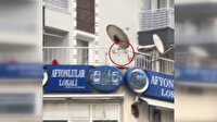 İzmir'de alkollü şahıs tartıştığı esnafa balkondan balta fırlattı