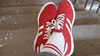 Belarus'ta ilginç olay: Kırmızı beyaz ayakkabı ve çorap giyen kadına 7bin 500 TL'lik ceza