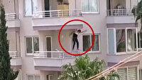 Mersin'de polisten kaçmaya çalışan zanlı balkondan aşağıya sarktı