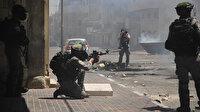 İşgalci İsrail'in insanlık dışı saldırılarını protesto eden Filistinlilere yine vahşi müdahele