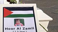Danimarka'da, işgalci İsrail'in saldırılarında hayatını kaybeden Filistinli çocuklar için anma töreni düzenlendi