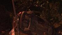 Sürücüsünün direksiyon hakimiyetini kaybettiği araç direk ile bahçe arasında asılı kaldı