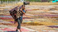 Köy köy dolaşıp topladığı halıları ekonomiye kazandırıyor