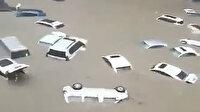 Çin'de sel felaketi: Otomobiller sular altında kaldı