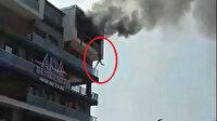 Denizli'de 5'inci kattaki dairesinde çıkan yangında alt kata sarkarak kurtuldu