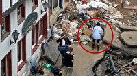 Almanya'daki sel felaketinde kendini çamura bulayan muhabir kovuldu