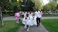 Düğün fotoğraflarını Taksim'de çektiren Kongolu çift vatandaşların ilgi odağı oldu
