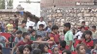 Diyarbakırlı çocuklar köy meydanına kurulan açık hava sinemasının tadını çıkardı