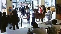 Program sırasında bayılan öğrenciyi Beşiktaş kaymakamı kucağında taşıdı