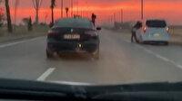 Şırnak'ta aracın camından sarkan kız yürekleri ağza getirdi