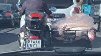 Diyarbakır'da motosiklet kasasında et taşıyan sürücü kamerada