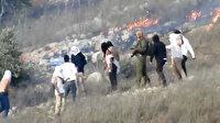 Yahudi işgalciler Filistinlilere ait arazileri ateşe verdi