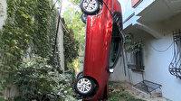 Fren yerine gaza bastı otomobili bahçeye yuvarlandı
