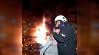 Erzurum'da 5 katlı binada korkutan yangın: Şoka giren kızı itfaiye memuru sarılarak sakinleştirdi