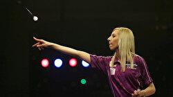 Dart queen Sherrock beats world's 11th seed man
