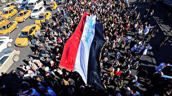 Iraqi security forces clash with hundreds of protesters in central Baghdad
