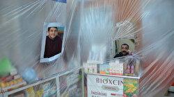 Eczacılardan koronavirüse karşı önlem: Tezgahların önlerine branda ve şerit çektiler