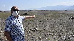 Sivas'ta baraj gölünde sular çekildi: Köy kalıntıları gün yüzüne çıktı