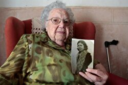 Rafaela Pons, 102, lives alone although her daughter visits her daily. She is a devoted supporter of Real Madrid soccer club and takes a spoonful of honey every day.