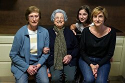 Fernandez poses for a portrait with her daughter Pili (left), granddaughter Flori (right) and her great granddaughter Ana.