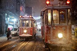 Snow can be seen falling on Istanbul's popular Istiklal Avenue.