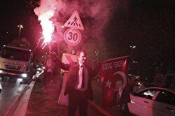 A supporter of Turkish President Tayyip Erdogan celebrates on a street in Istanbul, Turkey, April 16, 2017.