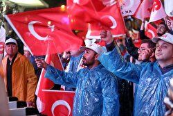 Supporters of AK party react at the party headquarters in Ankara, Turkey, April 16, 2017.