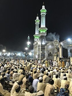 Because of the crowd some pilgrims who can't find an empty spot perform their prayers in the vicinity of the Kaaba.