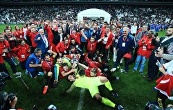 Footballers of Turkey celebrate their victory as they carry a massive Turkish flag after winning the cup in the European Amputee Football Federation (EAFF) European Championship final match between Turkey and England at Vodafone Park in Istanbul, Turkey on October 9, 2017.