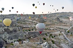 Charming photos capture the beauty of the autumn season in Turkey's Cappadocia as visitors observe the sunrise, fairy chimneys and picturesque landscapes aboard the popular hot-air balloon tours. Cappadocia is preserved as a UNESCO World Heritage site and is famous for its chimney rocks, hot air balloon trips, underground cities and boutique hotels carved into rocks. Cappadocia is a popular tourism destination, and attracted 120,000 tourists in the first half of 2017.