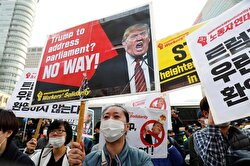 Protesters take part in a rally against U.S. President Donald Trump near South Korea's presidential Blue House in central Seoul, South Korea, November 7, 2017. 