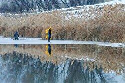 Fishing on frozen lake in Van