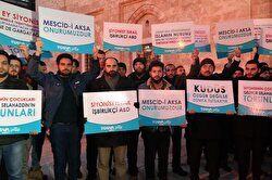 """Crowds gathered following Muslims' morning prayer in Turkey's Bursa to denounce Trump's decision to recognize Jerusalem as Israel's capital. Protestors held banners that read """"Jerusalem is our honor"""" and """"If Jerusalem is not free, the whole world is in captivity."""""""