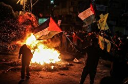 Demonstrators burn tyres and shout slogans during a protest against the US President Donald Trump's recognition of Jerusalem as Israel's capital, in Gaza City, Gaza on December 07, 2017.