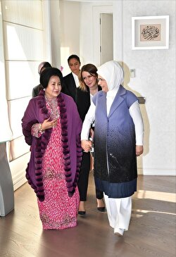 Turkey's first lady Emine Erdoğan (R) walks with a leader's wife while hosting a luncheon for wives of the leaders, who attend the extraordinary summit of Organization of Islamic Cooperation (OIC) in Istanbul, Turkey on December 13, 2017.