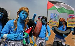 Palestinians dressed as Avatar characters protest near Gaza-Israel border