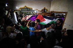 Thousands of Palestinians attend the funeral ceremony of Razan Ashraf Najjar, 21, a female paramedic who was shot dead by Israeli forces while healing wounded demonstrators during 'Great March of Return' protests in Khan Yunis on Friday, in Huzaa neighborhood of Khan Yunis, Gaza on June 02, 2018.