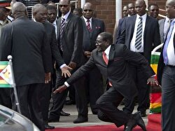 Former Zimbabwe President Robert Mugabe fell to the ground on Feb. 4, 2015, while departing from an African Union meeting.