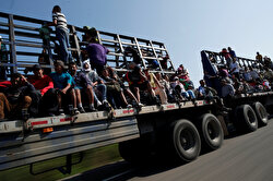 Migrants, part of a caravan traveling en route to the United States