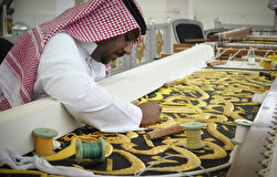 A man sews the Kiswah, the cloth that covers the Kaaba which will be changed on the eve of Eid Al-Adha in Mecca, Saudi Arabia onAugust 08, 2019. 700 kg of raw silk, and 120 kg of gold and silver thread were used by 200 workers to make the Kiswah.