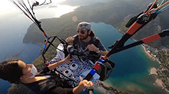 Paragliders offered traditional Turkish coffe...