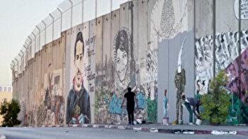 Palestinian graffiti artist paints stories on West Bank barrier