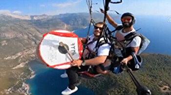 Adventurer plays drum while skydiving over Turkey's idyllic Oludeniz and underwater