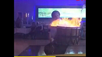 Wedding drummer's stunt goes wrong when he tries to 'heat up' stage