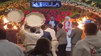Giant tire welcomes bride and groom into wedding hall in bizarre trucker ceremony