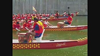 Thousands participate in dragon boat race to mark Duanwu Festival in east China